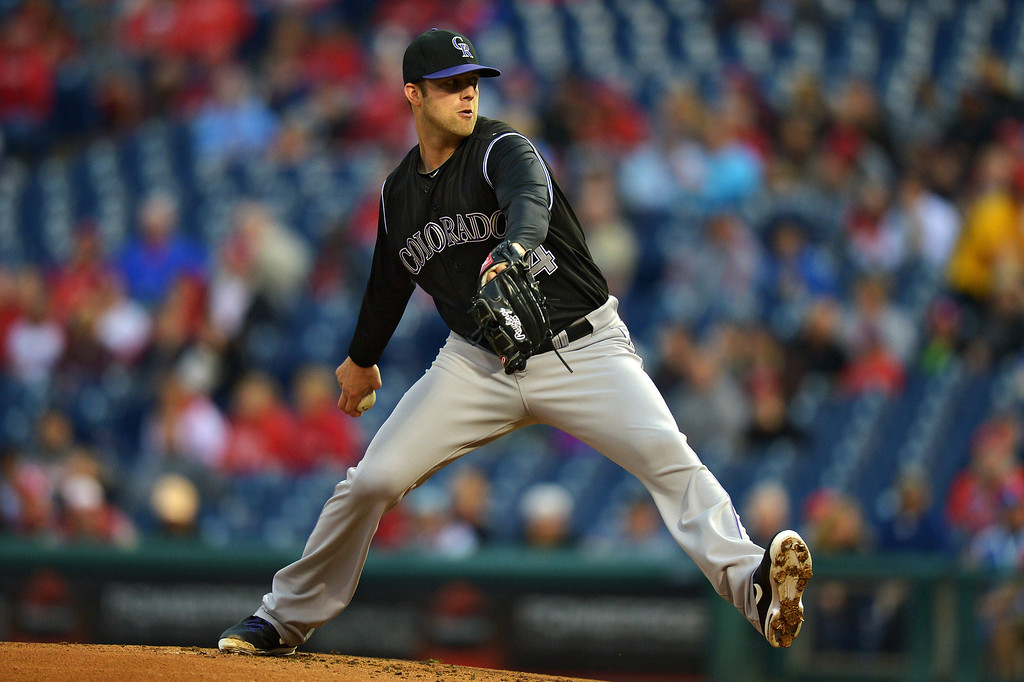. Starter Jordan Lyles #24 of the Colorado Rockies delivers a pitch in the first inning against the Philadelphia Phillies at Citizens Bank Park on May 28, 2014 in Philadelphia, Pennsylvania.  (Photo by Drew Hallowell/Getty Images)