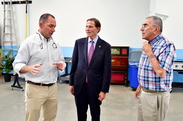 7/26/2019 Mike Orazzi | Staff U.S. Sen. Richard Blumenthal talks with Pepco Vice President Tony Sposato and President Bob Sposato on Lake Avenue in Bristol during a factory tour on Friday.