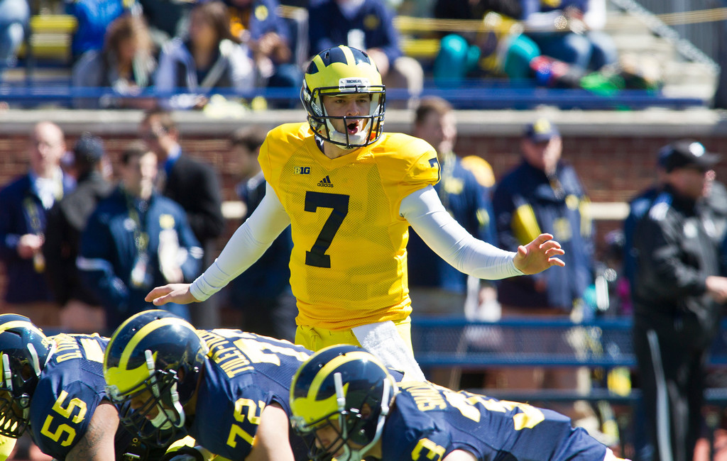 . Michigan quarterback Shane Morris (7) shouts an audible to his offensive line before a snap, during the football team\'s annual spring game, Saturday, April 5, 2014, in Ann Arbor, Mich. (AP Photo/Tony Ding)