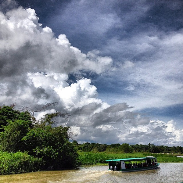 Water taxi under the clouds, en route to Tortuguero, Caribbean Costa Rica.