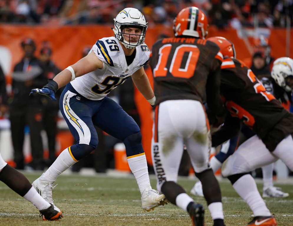 . San Diego Chargers defensive end Joey Bosa (99) defends in the second half of an NFL football game against the Cleveland Browns, Saturday, Dec. 24, 2016, in Cleveland. (AP Photo/Ron Schwane)