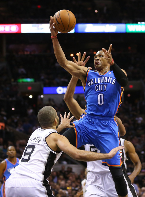 . Russell Westbrook #0 of the Oklahoma City Thunder goes for a shot against Tony Parker #9 of the San Antonio Spurs in the third quarter in Game One of the Western Conference Finals during the 2014 NBA Playoffs at AT&T Center on May 19, 2014 in San Antonio, Texas.  (Photo by Ronald Martinez/Getty Images)