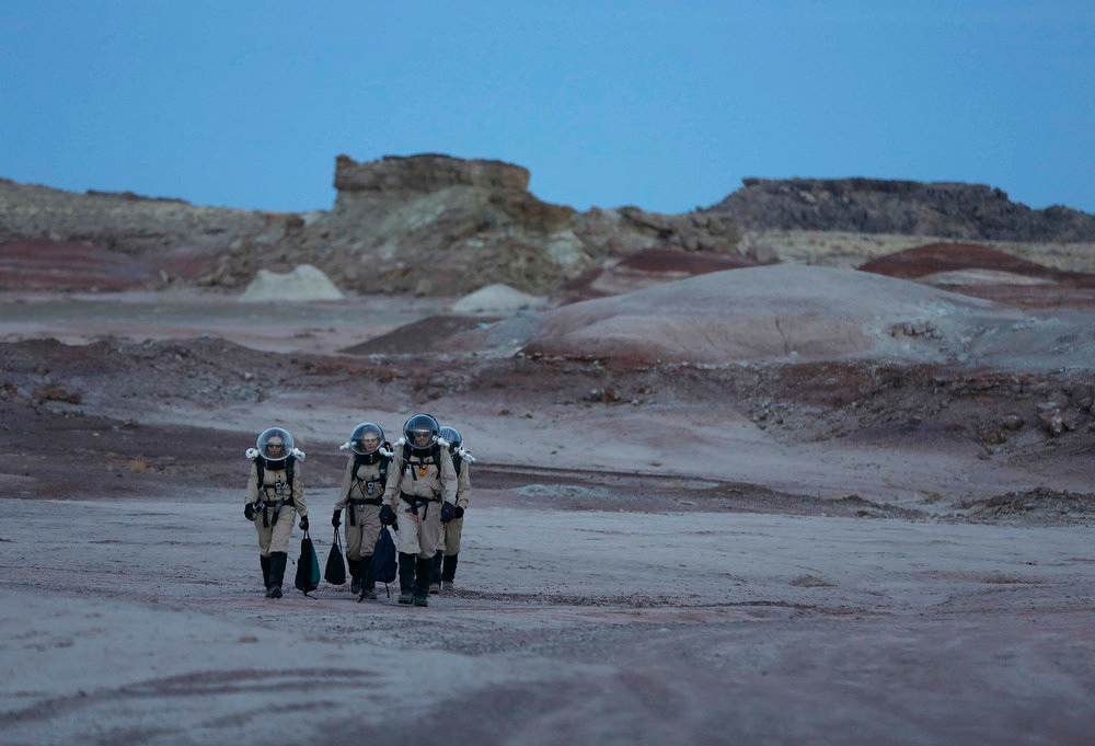 Description of . Members of Crew 125 EuroMoonMars B mission return after collecting geologic samples for study at the Mars Desert Research Station (MDRS) in the Utah desert March 2, 2013.  REUTERS/Jim Urquhart