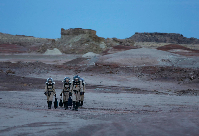 . Members of Crew 125 EuroMoonMars B mission return after collecting geologic samples for study at the Mars Desert Research Station (MDRS) in the Utah desert March 2, 2013.  REUTERS/Jim Urquhart