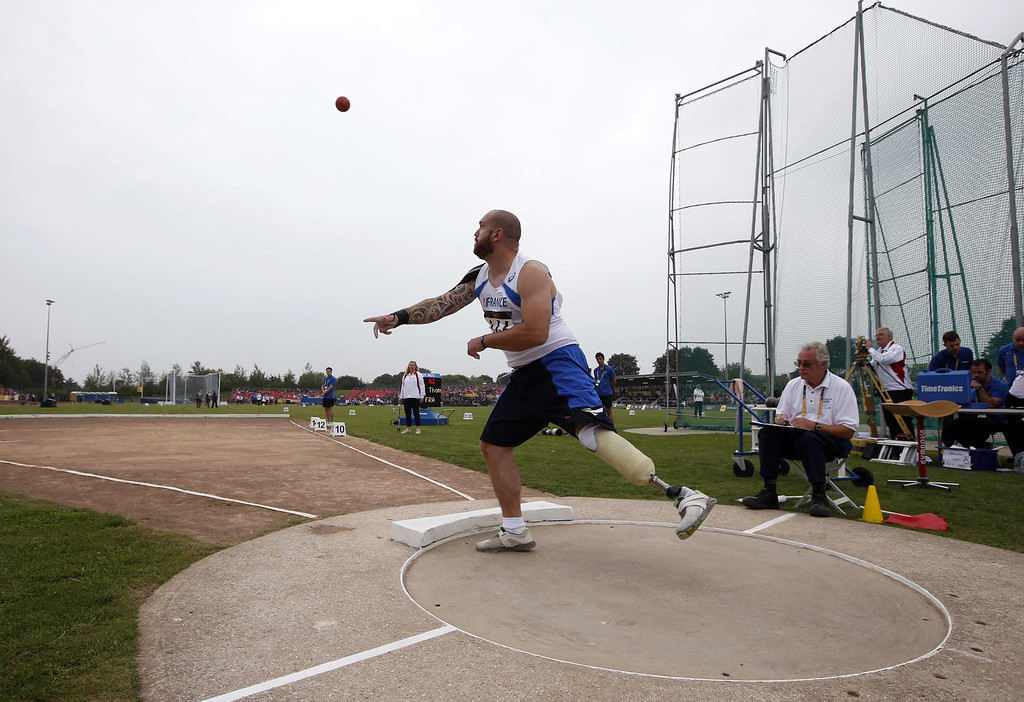 . France\'s Thomas Brun competes in the men\'s shot put during the Invictus Games at Queen Elizabeth II Park in London on September 11, 2014. The battle for medals got under way Thursday at the Invictus Games, a Paralympics-style event for wounded troops organised by Britain\'s Prince Harry. AFP PHOTO/ADRIAN DENNISADRIAN DENNIS/AFP/Getty Images