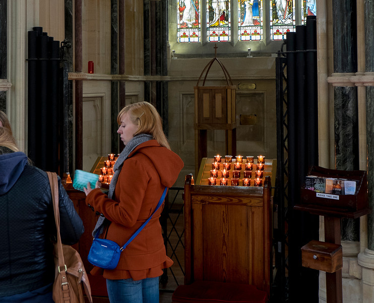 Lighting candles at the chapel.