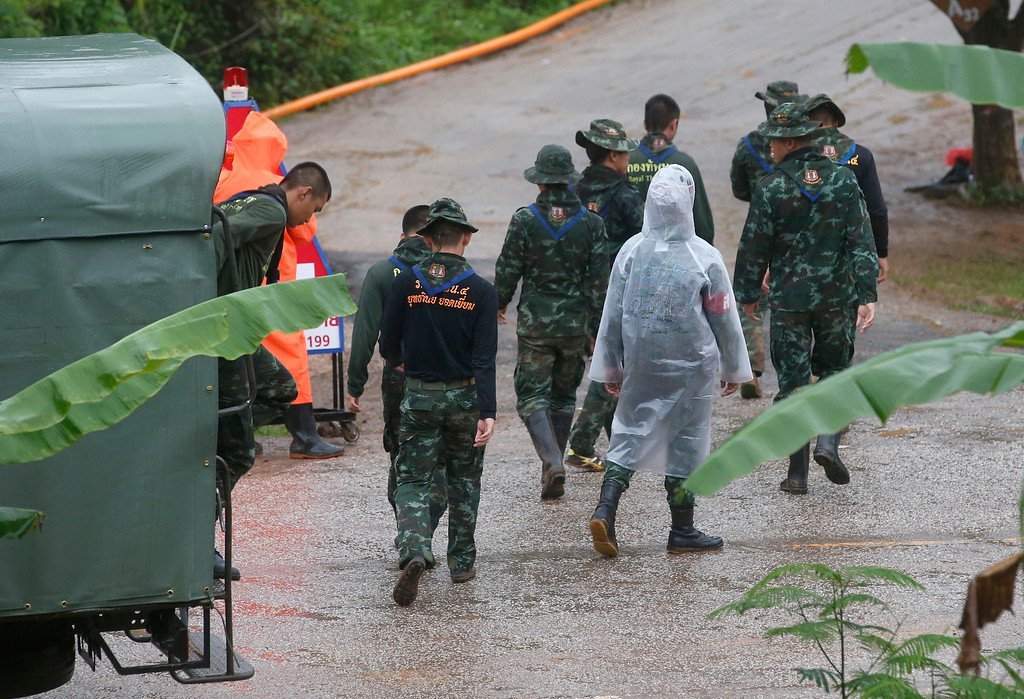 . Rescuers move to the entrance to a cave complex where five stil lwere trapped in Mae Sai, Chiang Rai province, northern Thailand Tuesday, July 10, 2018. The eight boys were rescued from the flooded cave. (AP Photo/Sakchai Lalit)