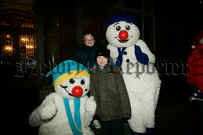 Gary and Shane Murphy pictured with snowmen at the switching of the Christmas lights in Newry on Thursday last. 06W48N11