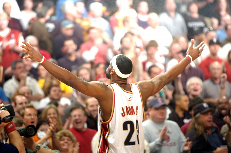 . PHOTO BY DAVID RICHARD LeBron James faces cheering fans a playoff game at Quicken Loans Arena.