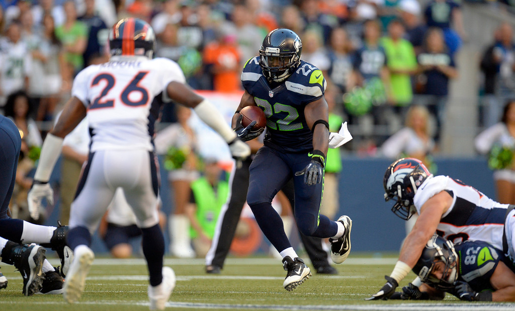 . SEATTLE, WA. - AUGUST 17: Seattle Seahawks running back Robert Turbin (22) finds a big hole in the Denver Broncos defense as he picks up some yardage in the first quarter August 17, 2013 at Century Link Field. (Photo By John Leyba/The Denver Post)