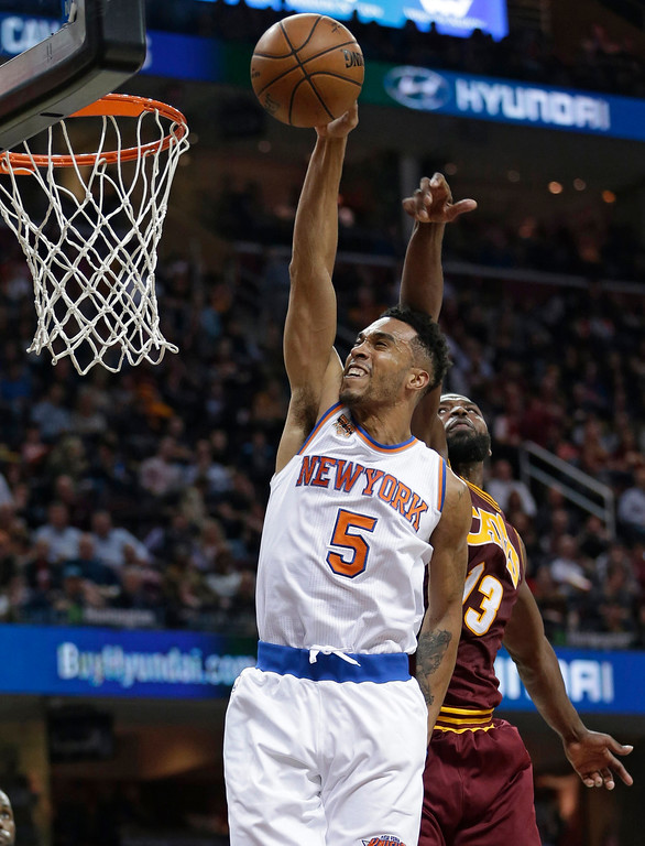. New York Knicks\' Courtney Lee (5) drives to the basket against Cleveland Cavaliers\' Tristan Thompson (13) in the second half of an NBA basketball game, Thursday, Feb. 23, 2017, in Cleveland. The Cavaliers won 119-104. (AP Photo/Tony Dejak)