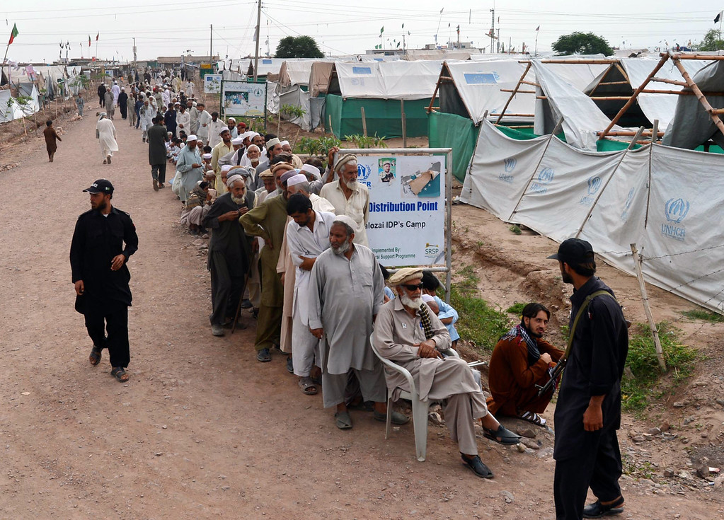 . Internally displaced Pakistanis queue up as they wait for their turn to cast their vote outside a polling station in Pakistan\'s largest refugee camp, Jalozai some 35 kms outside Peshawar on May 11, 2013. Pakistanis queued up to vote in landmark elections on May 11, defying Taliban attacks to cast their ballots in polls marking a historic democratic transition for the nuclear-armed state. A. MAJEED/AFP/Getty Images