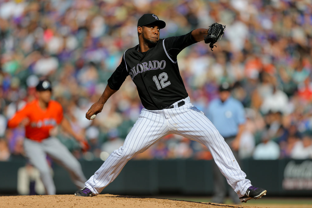 . Relief pitcher Juan Nicasio #12 of the Colorado Rockies delivers to home plate during the seventh inning against the Miami Marlins at Coors Field on August 24, 2014 in Denver, Colorado. The Rockies defeated the Marlins 7-4. (Photo by Justin Edmonds/Getty Images)