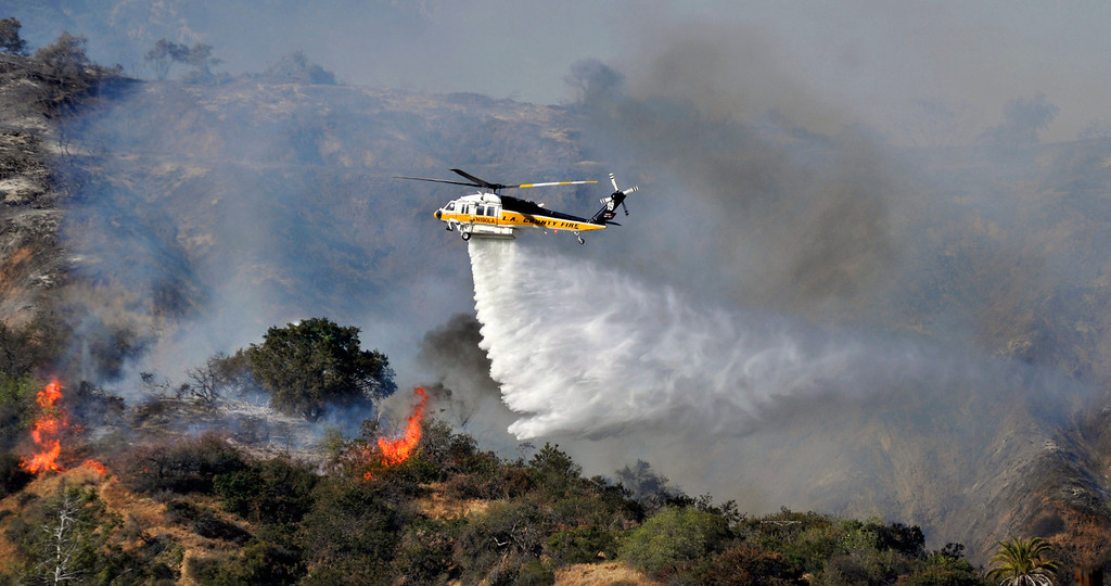 . Firefighters from all surrounding agencies came in to help the Monrovia Fire Dept. battle a major wildfire in the foothills above their city, Saturday April 20, 2013.  (Mike Mullen)