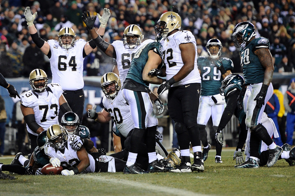 . PHILADELPHIA, PA - JANUARY 04:  Mark Ingram #22 of the New Orleans Saints runs for a 4 yard touchdown in the third quarter against the Philadelphia Eagles during their NFC Wild Card Playoff game at Lincoln Financial Field on January 4, 2014 in Philadelphia, Pennsylvania.  (Photo by Maddie Meyer/Getty Images)