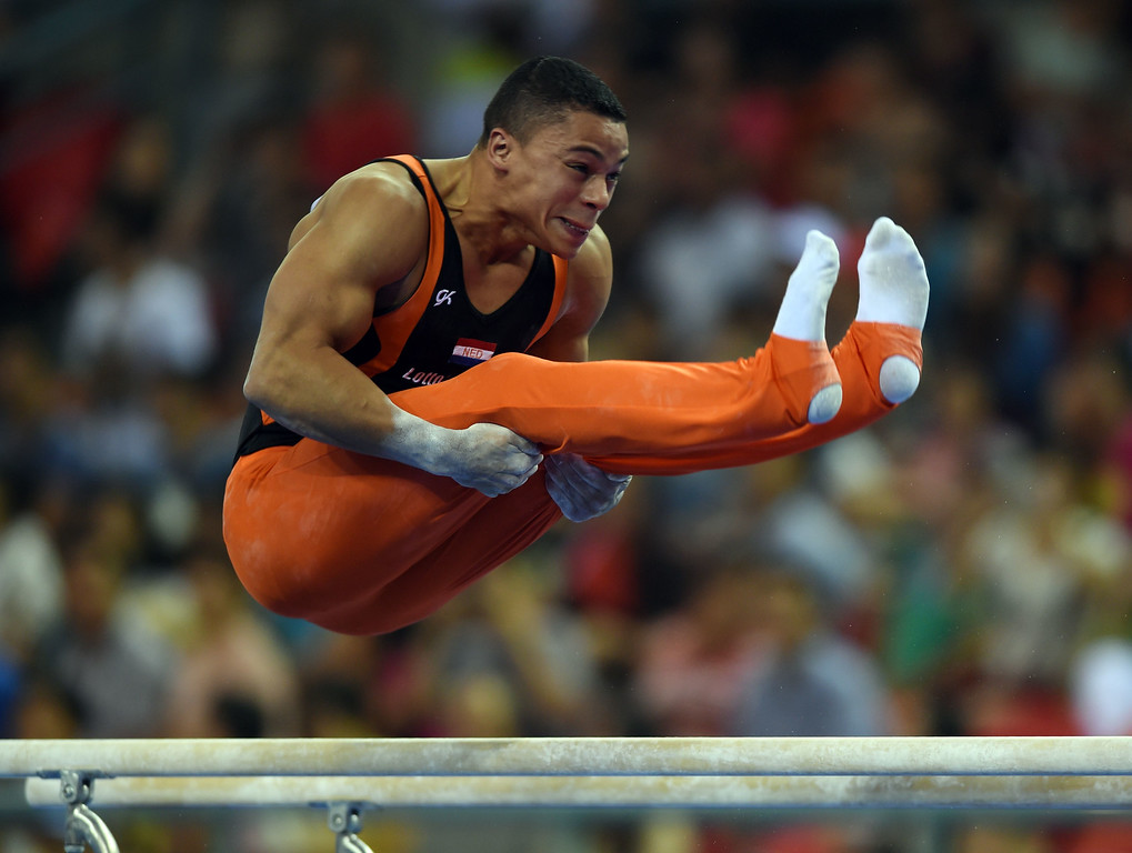 . Jeffrey Wammes of the Netherlands competes on the parallel bars during the men\'s qualification at the Gymnastics World Championships in Nanning, in China\'s southern Guangxi province on October 3, 2014. GREG BAKER/AFP/Getty Images