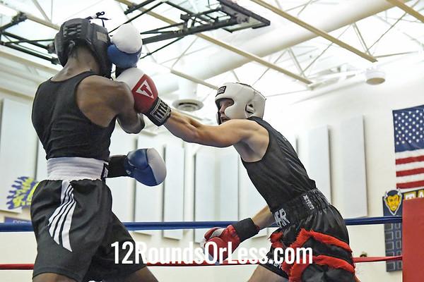 Bout #3:  Toby Kneer, Red Gloves   vs   Teashawn Yancy, Blue Gloves  -  132 Lbs.