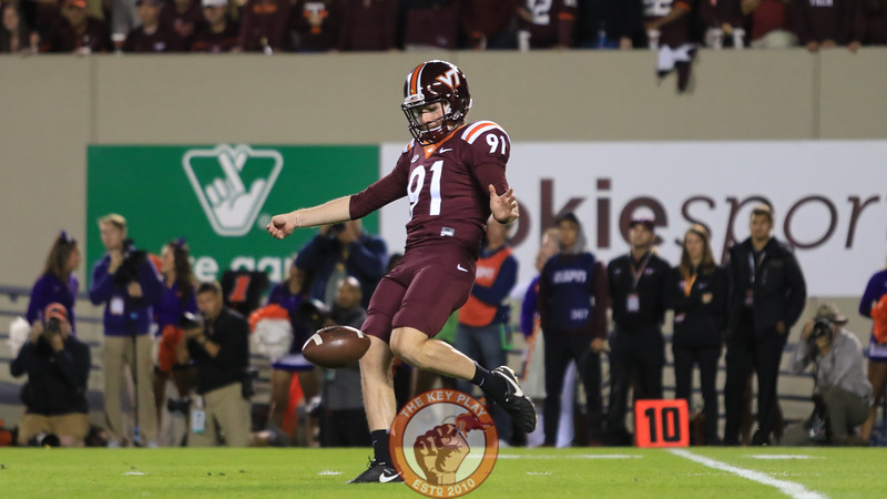 Punter Oscar Bradburn punts the ball away in the first quarter. (Mark Umansky/TheKeyPlay.com)