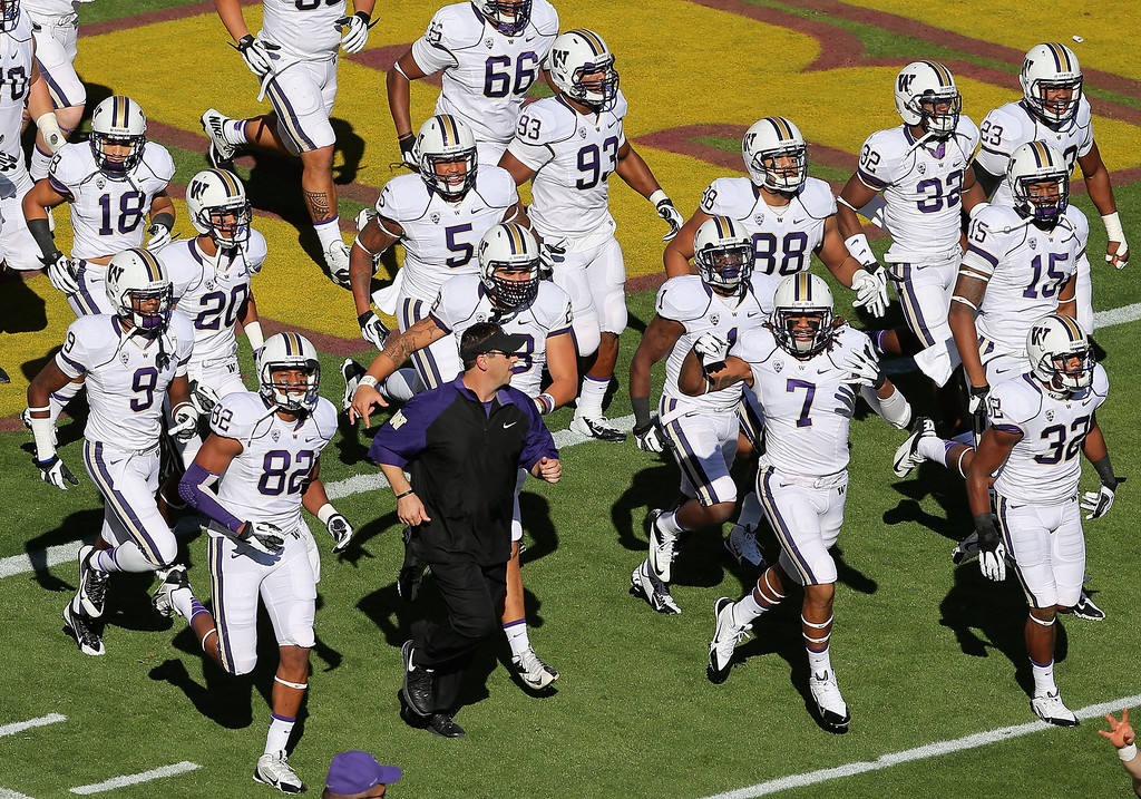 . Head coach Steve Sarkisian of the Washington Huskies leads teammates out onto the field before the college football game against the Arizona State Sun Devils at Sun Devil Stadium on October 19, 2013 in Tempe, Arizona.  The Sun Devils defeated the Huskies 53-24.  (Photo by Christian Petersen/Getty Images)