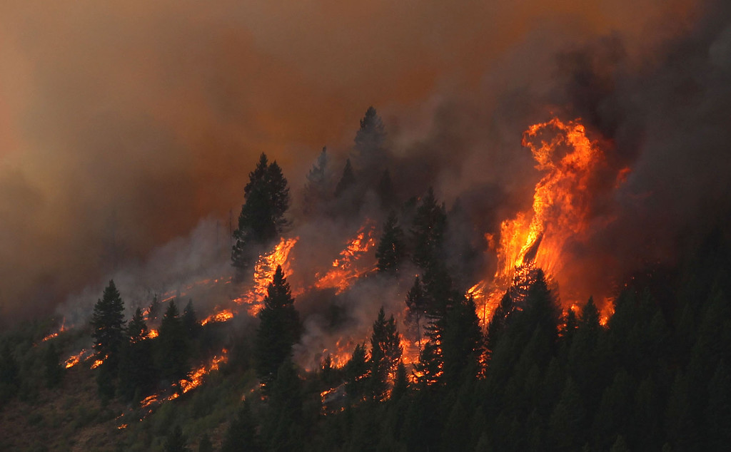 . The 80,300-acre Elk Fire Complex burns across Elmore County, Idaho , Sunday Aug. 11, 2013.  The Elk Complex Fire has so far charred more than 125-square-miles and is now the nation\'s top wildfire priority, according to federal wildfire officials. (AP Photo/Times-News,Ashley Smith) Mandatory  Credit