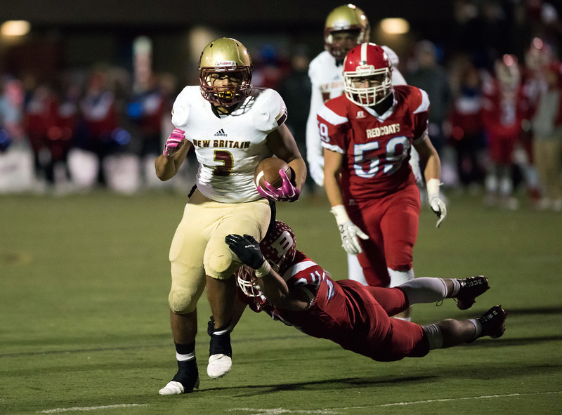 11/16/18  Wesley Bunnell | Staff  New Britain vs Berlin football at Sage Park on Friday night. Shawn Robinson (3) is pursued by Alex Halkias (34).