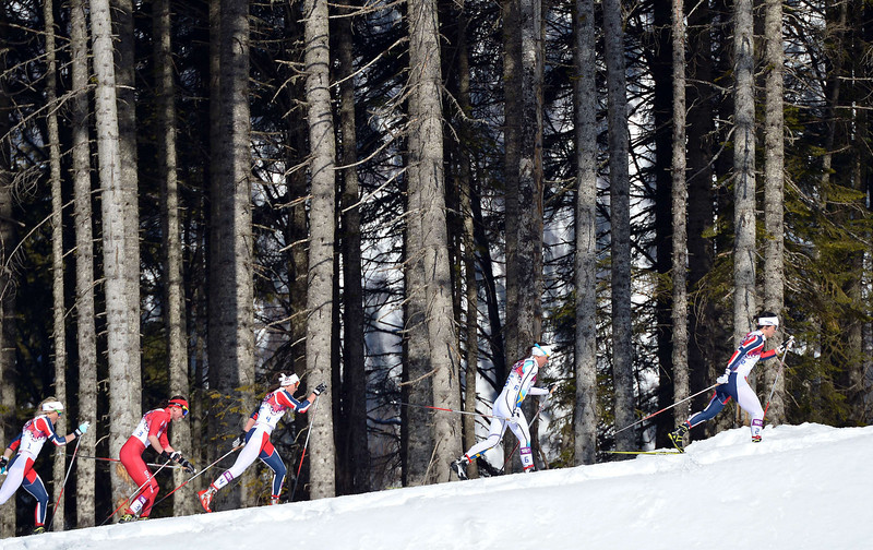. Norway\'s Marit Bjoergen (R) competes in the Women\'s Cross-Country Skiing 7,5km + 7,5km Skiathlon at the Laura Cross-Country Ski and Biathlon Center during the Sochi Winter Olympics on February 8, 2014 in Rosa Khutor.  (ALBERTO PIZZOLI/AFP/Getty Images)