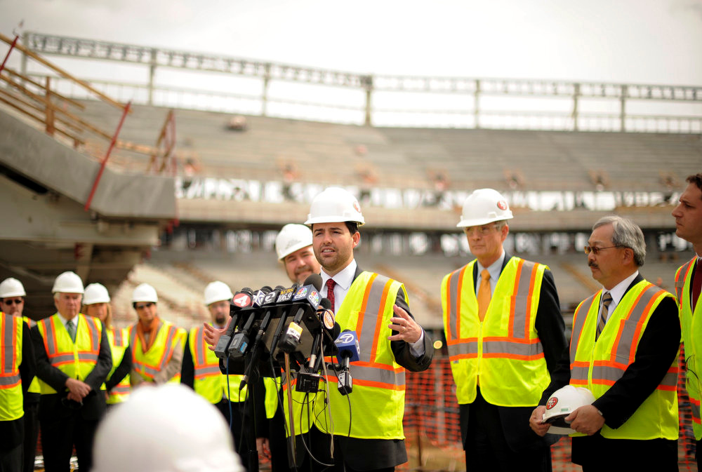 Description of . San Francisco 49'ers CEO Jed York speaks to reporters at Santa Clara Stadium, the future home of the NFL's San Francisco 49'ers, in Santa Clara, California  March 6, 2013. The stadium is scheduled to open in time for the 2014 NFL season.  REUTERS/Noah Berger
