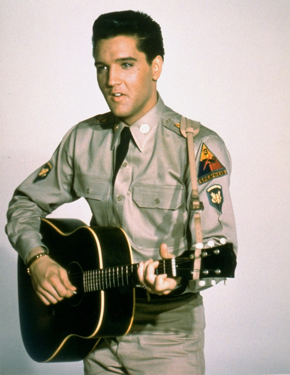 ". This is a publicity photo from the 1960 film ""G.I. Blues\"", starring Elvis Presley as a guitar playing tank gunner with the American Army in West Germany.  (AP Photo)"