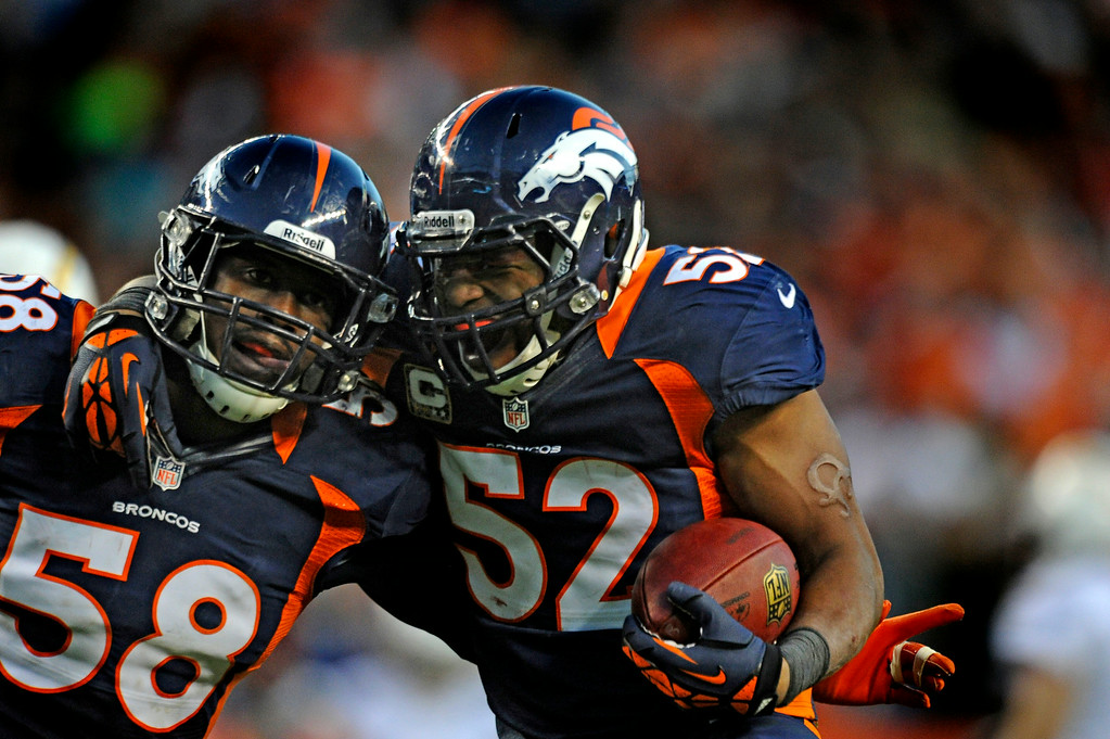 . Linebacker Von Miller, left, celebrates with former Bronco Wesley Woodyard during the third quarter of the November 2012 game against the Chargers. (Tim Rasmussen, The Denver Post)