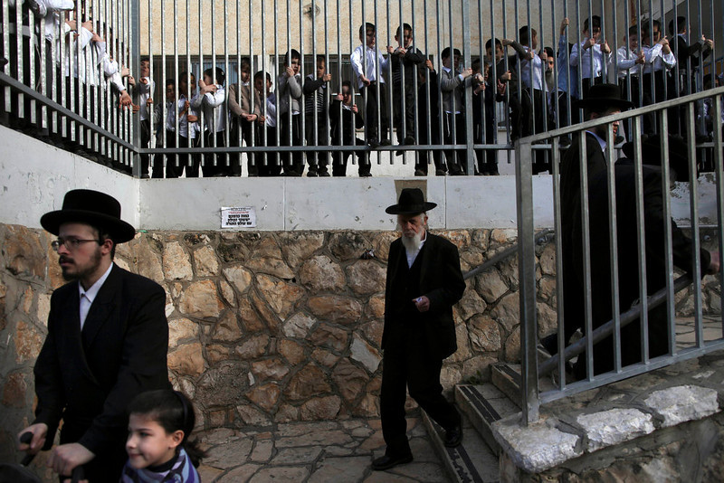 . Ultra-Orthodox Jews arrive to vote in legislative elections, at a school in Bnie Brak, Israel, Tuesday, Jan. 22, 2013.  Israelis began trickling into polling stations Tuesday morning to cast their votes in a parliamentary election expected to return Prime Minister Benjamin Netanyahu to office despite years of stalled peacemaking with the Palestinians and mounting economic troubles.(AP Photo/Oded Balilty)