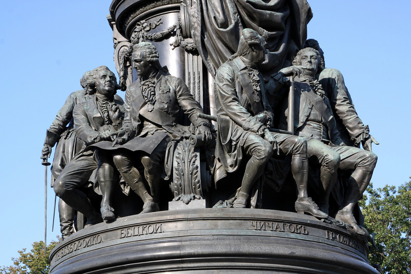 Close-up photo of the smaller statues at the base of the Catherine the Great statue.
