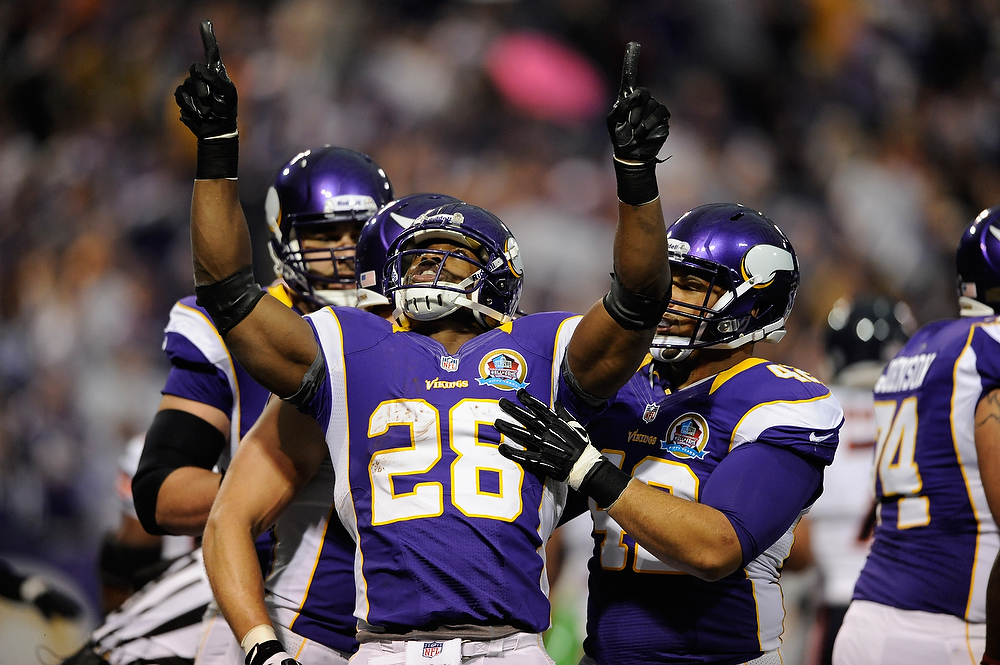 . Adrian Peterson #28 of the Minnesota Vikings celebrates a touchdown during the first quarter of the game against the Chicago Bears on December 9, 2012 at Mall of America Field at the Hubert H. Humphrey Metrodome in Minneapolis, Minnesota. (Photo by Hannah Foslien/Getty Images)