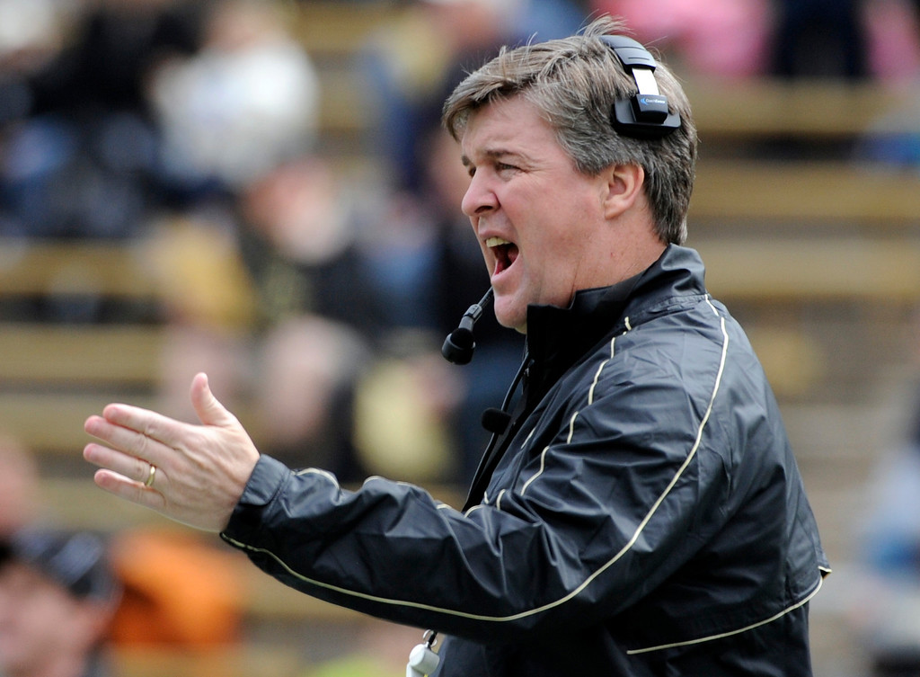 . BOULDER, CO.- APRIL13: New head coach Mike MacIntyre directs his players from the field. The University of Colorado football team hosts its spring football game at Folsom Field under the direction of new head coach Mike MacIntyre. (Photo By Kathryn Scott Osler/The Denver Post)