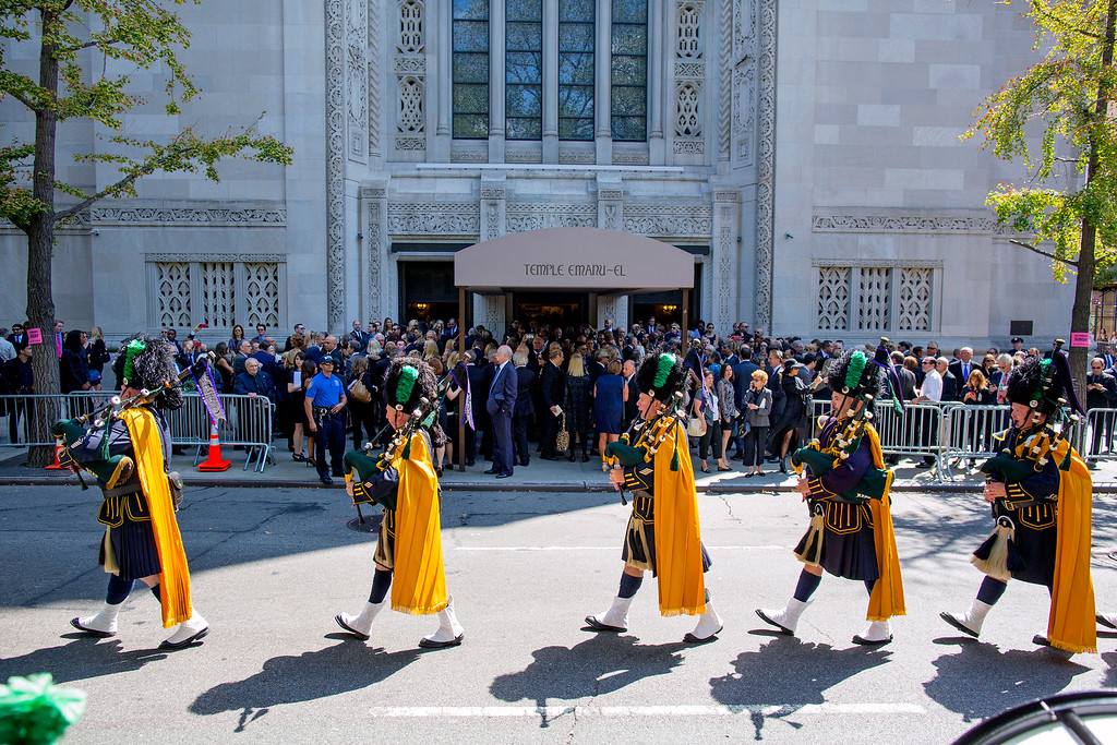 . Bagpipers march from the funeral service for comedian Joan Rivers at Temple Emanu-El in New York Sunday, Sept. 7, 2014. Rivers died Thursday at 81. (AP Photo/Craig Ruttle)