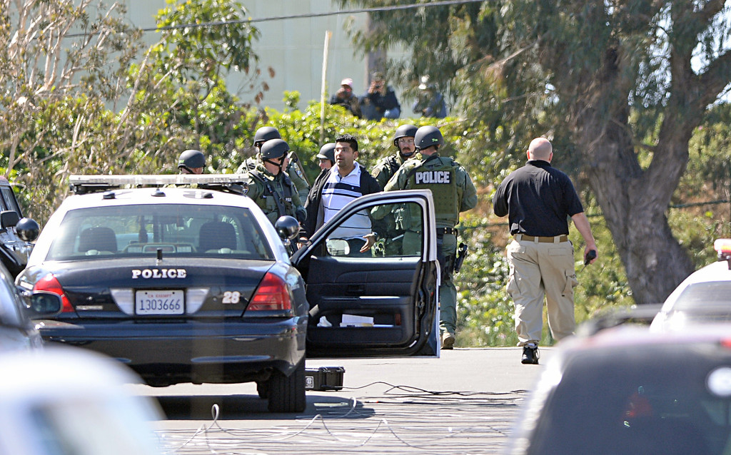 . SWAT team escorts a person from the El Segundo Popcornopolis offices near El Segundo Blvd. An armed female employee took another employee hostage, which ended peacefully  four hours later about noon. Photo by Brad Graverson 4-16-13