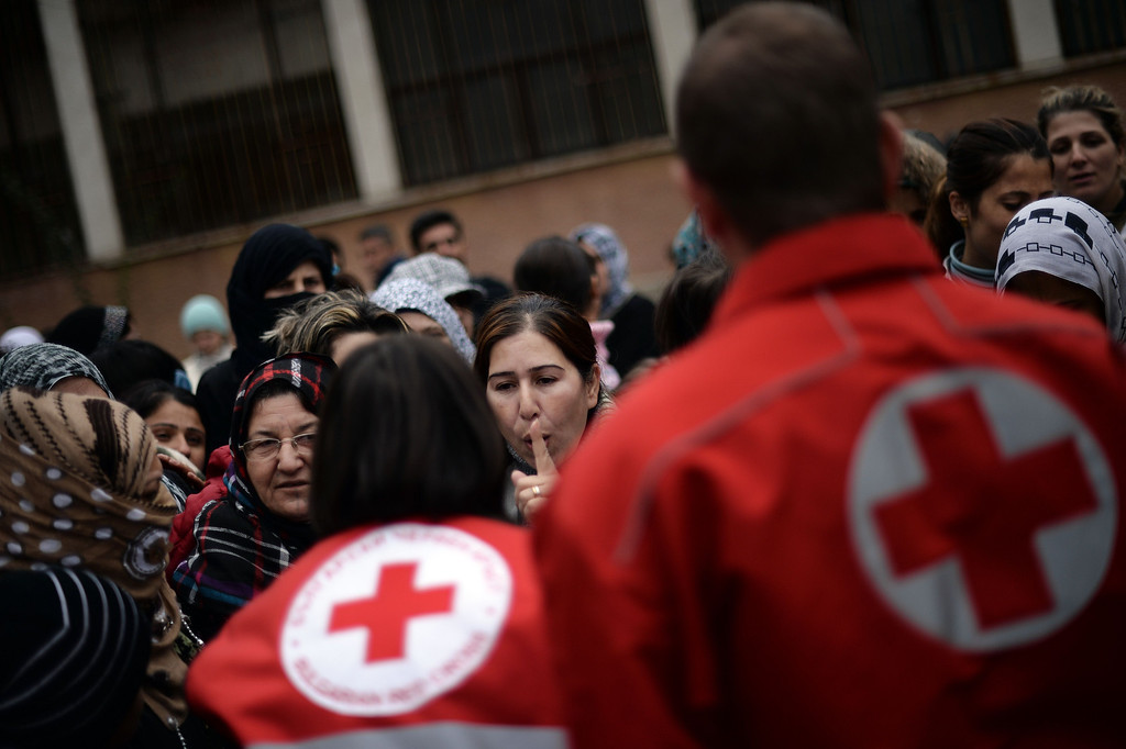 . Bulgarian Red Cross volunteers distribute food, clothes and blankets to Syrian refugees at a refugee center in Sofia on October 3, 2013. Boris Cheshirkov, spokesman for the UN Refugee Agency in Bulgaria, warned this week about food shortages in the shelters. In an accommodation centre near Sofia, one blanket had to be shared between three people, he said. More than two million people have fled Syria since the war broke out there in 2011, mostly to neighbouring Lebanon, Turkey, Jordan and Iraq.  DIMITAR DILKOFF/AFP/Getty Images