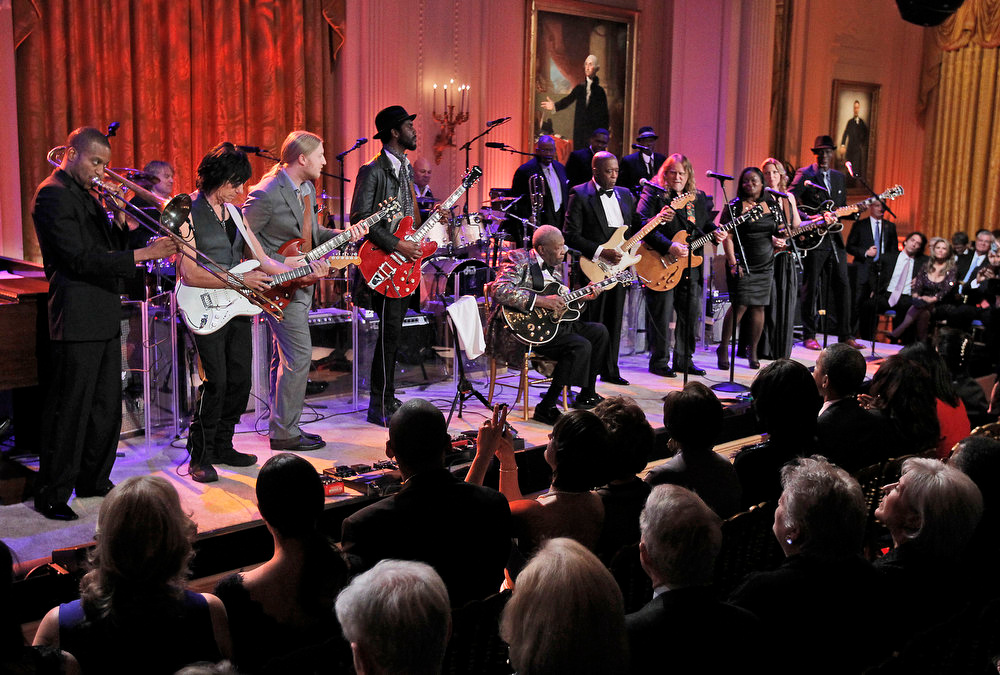 Description of . President Barack Obama and first lady Michelle Obama listen to a performance during the White House Music Series saluting Blues Music in recognition of Black History Month, Tuesday, Feb. 21, 2012, in the East Room of the White House in Washington. On stage from left to right are Troy ìTrombone Shortyî Andrews, Jeff Beck, Derek Trucks, Gary Clark, Jr., B.B. King, Buddy Guy, Warren Haynes, Shemekia Copeland, Susan Tedeschi and Keb Mo. (AP Photo/Pablo Martinez Monsivais)