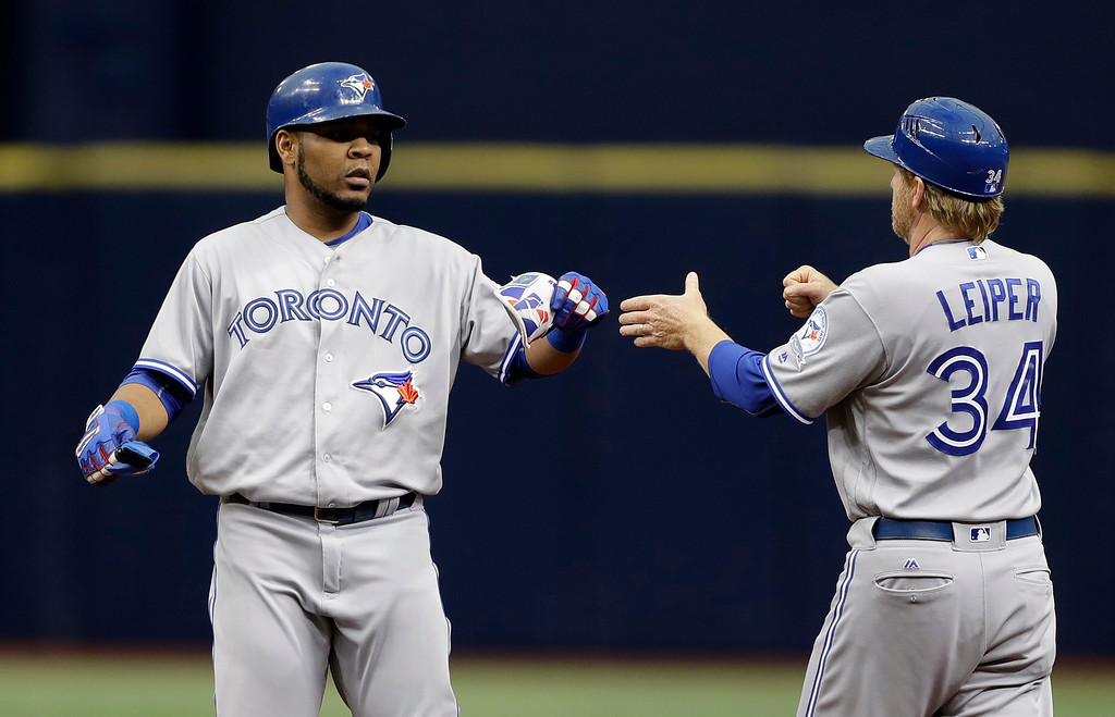 . Toronto Blue Jays\' Edwin Encarnacion celebrates with first base coach Tim Leiper (34) after his double off Tampa Bay Rays starting pitcher Chris Archer during the first inning of a baseball game Sunday, Sept. 4, 2016, in St. Petersburg, Fla. (AP Photo/Chris O\'Meara)