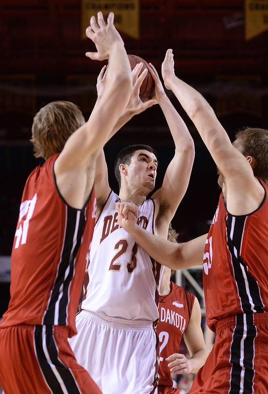 . DENVER, CO. - FEBRUARY 8, 2014: Denver guard Brett Olson fought his way through South Dakota defenders for a shot in the second half. The University of Denver defeated South Dakota 75-67 Saturday evening, February 8, 2014. Photo By Karl Gehring/The Denver Post