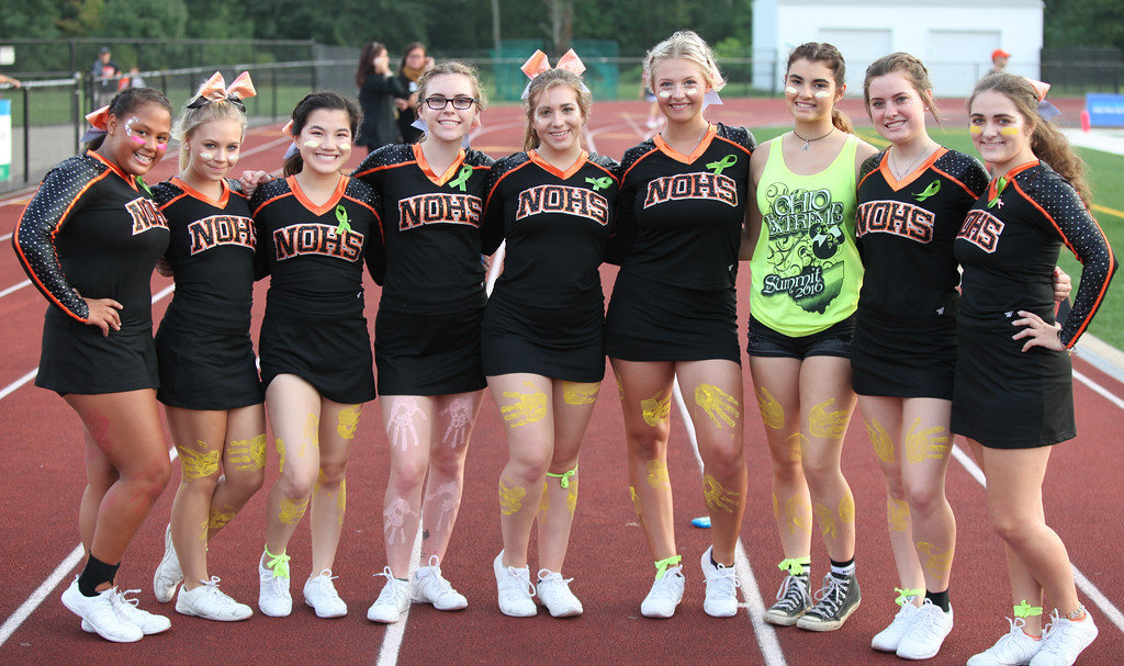 . Randy Meyers - The Morning Journal<br> The North Olmsted varsity cheerleaders are ready for Friday\'s game against Avon.