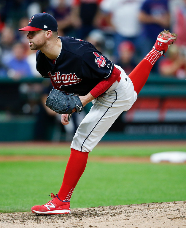 . Cleveland Indians starting pitcher Corey Kluber delivers against the Detroit Tigers during the ninth inning in a baseball game, Tuesday, Sept. 12, 2017, in Cleveland. Kluber pitched a complete game and helped the Indians to their 20th consecutive win. (AP Photo/Ron Schwane)