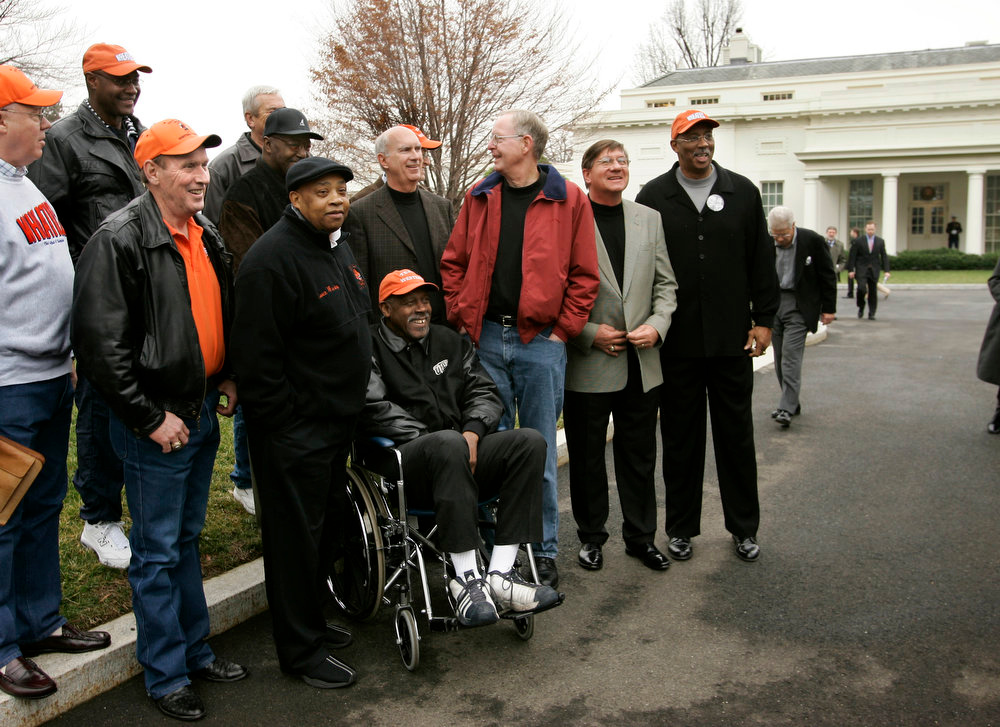 Description of . Members of the 1966 Texas Western College mens basketball team gather outside the West Wing of the White House after celebrations of their victory in the NCAA men's basketball national championship of 40 years ago as part of Black History Month observances in Washington, Thursday, Feb. 23, 2006. They changed collegiate athletics forever by starting an all-black lineup for the first time in the NCAA playoffs and upsetting the favored University of Kentucky to win the national title. Their exploits are dramatized in a new film called