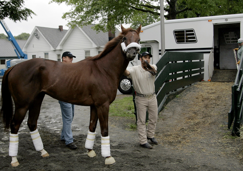 . John Servis, left, the trainer for Smarty Jones, watches as groom Mario Arrigas loads the Kentucky Derby and Prekness winner on a trailer a day after he finished second in the Belmont Stakes at Belmont Race Track in Elmont, N.Y., Saturday, June 6, 2004. (AP Photo/Ed Betz)
