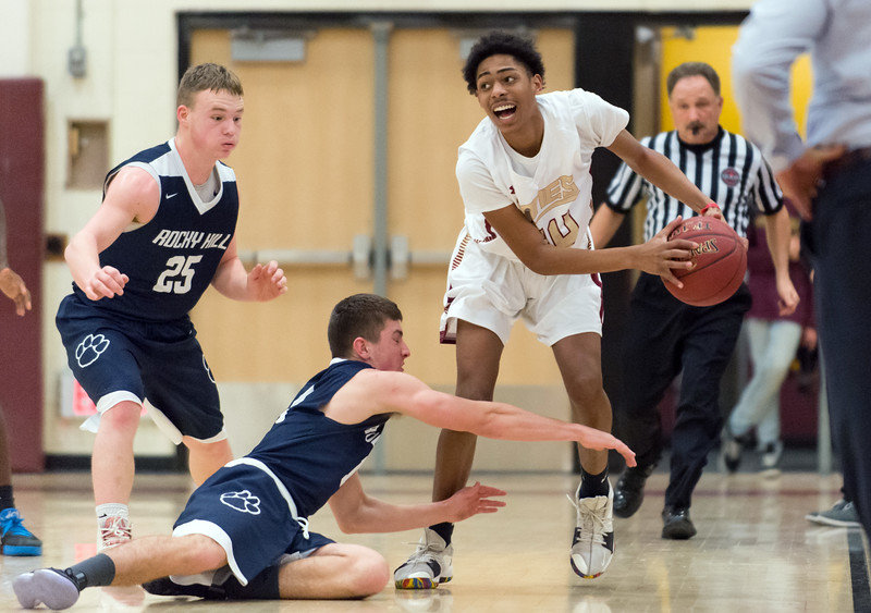 01/08/19  Wesley Bunnell | Staff  New Britain boys basketball defeated Rocky Hill in a home game on Tuesday night. David Quinones (44) scoops up a loose ball.