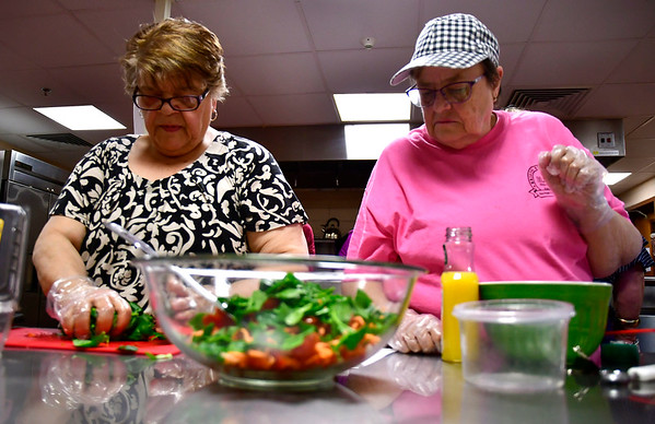 1/15/2020 Mike Orazzi | StaffrLouise Shepard and Ellen Judd during a cooking class at the Bristol Senior Center on Wednesday. r