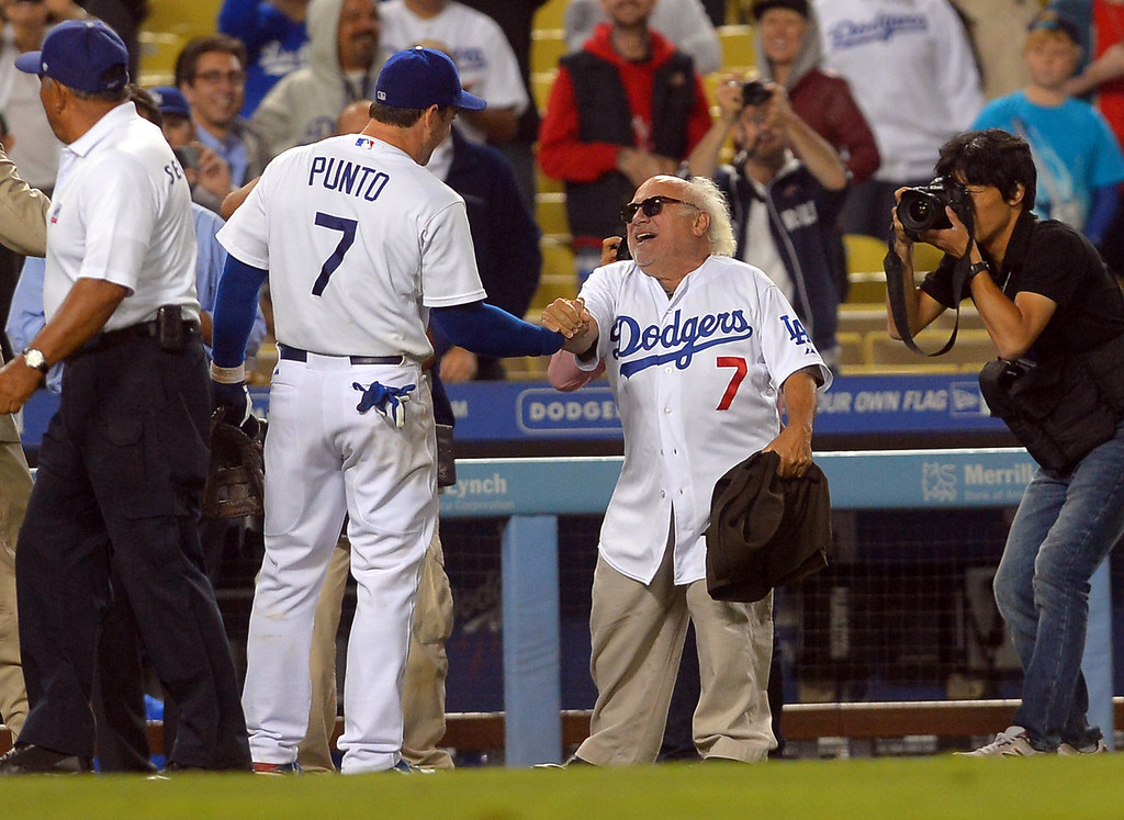 . Danny DeVito congratulates Nick Punto following the Dodgers 4-2 victory over the Mets August 12, 2013.  The Dodgers are hosting the Mets for a three game series. (Andy Holzman/Los Angeles Daily News)