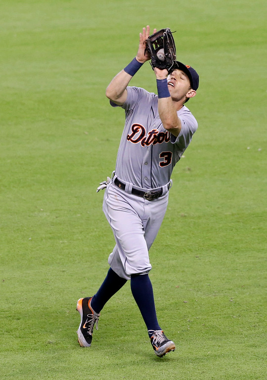 . Detroit Tigers second baseman Ian Kinsler makes the catch and the out on Houston Astros\' Matt Dominguez in the fourth inning of a baseball game Saturday, June 28, 2014, in Houston. (AP Photo/Pat Sullivan)