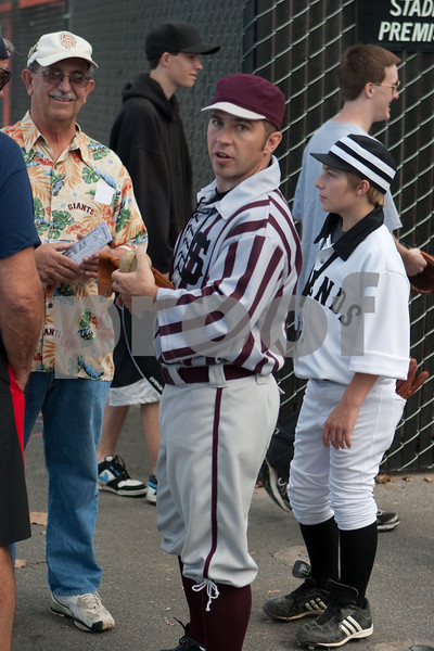 The Legends bat boy and one of the Stogies players before the fans entered the field.