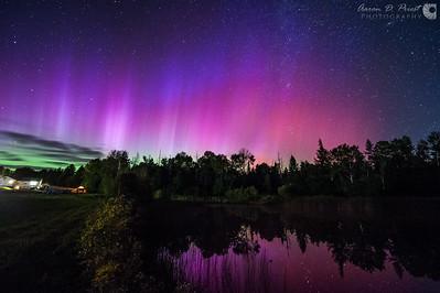 Aurora borealis over my back yard pond in Lee, Maine