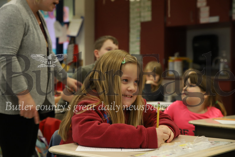 Maycie Livingston (first grade) smiles while thinking about what to write for her Mother's Day letter. Seb Foltz/Butler Eagle